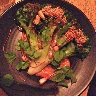 Charred broccoli, mustard seeds, and cancha